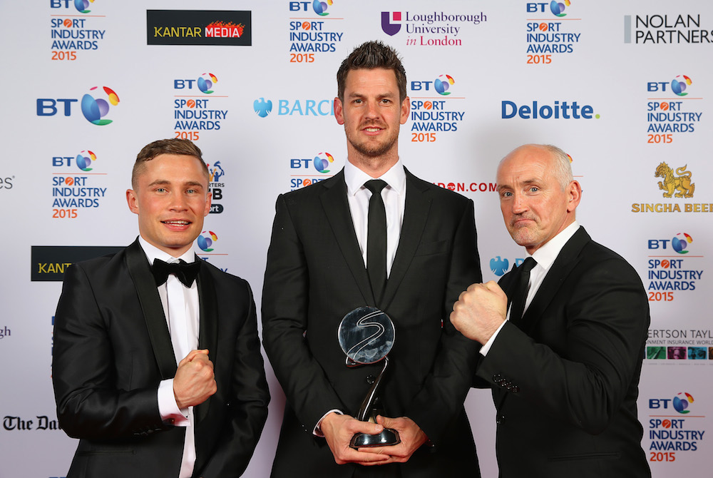 Carl Frampton (L) and Barry McGuigan (R) pose with the winner of the Brand of the Year Award, sponsored by Pinsent Masons to adidas