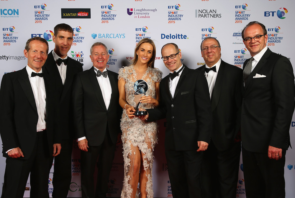 Martin Brundle (3L) and Carmen Jorda (C) pose with the winners of the Participation Event of the Year award sponsored by Robertson Taylor presented to Prudential RideLondon 2014