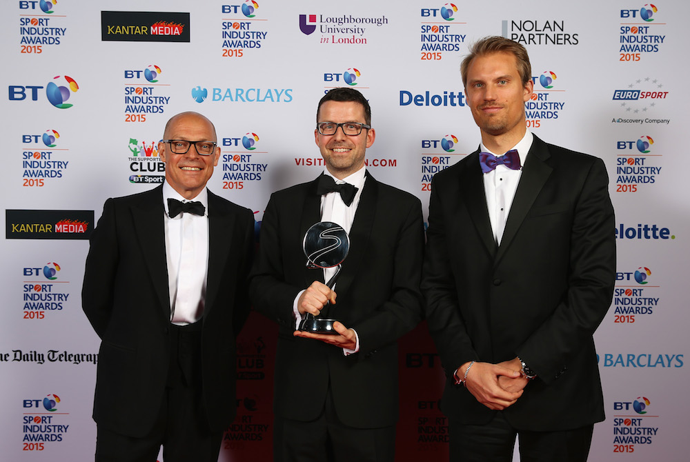 Sir Dave Brailsford (L) poses with the Cutting Edge Sport Award winners, sponsored by Institute for Sports Business, Loughborough University in London to Sportrader Security Services