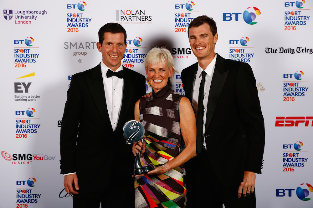 Tim Henman (L) presents The Outstanding Contribution to Sport to Judy Murray and son Jamie