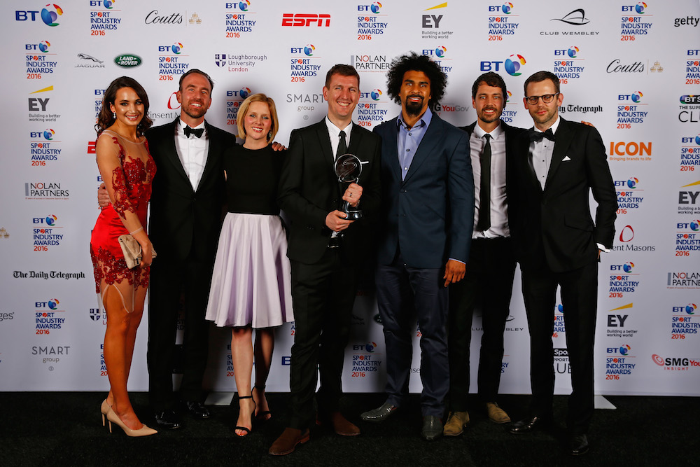 Singer Laura Wright (L) and boxer David Haye (3rdR) present the Best Entertainment Experience award to O2 Wear The Rose LIVE