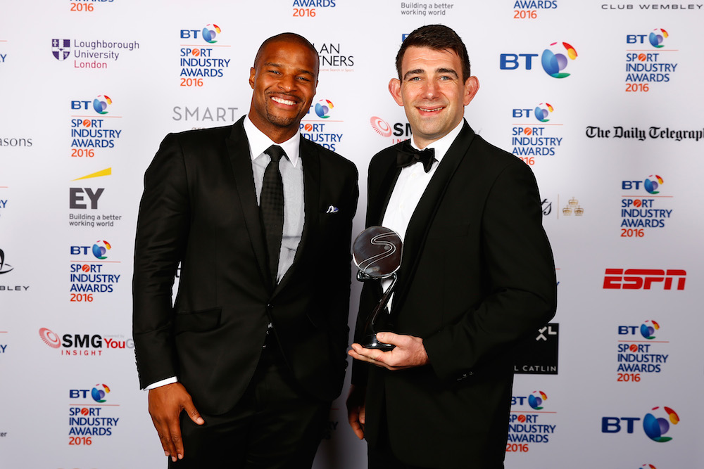 Osi Umenyiora (L) presents Brand of the Year in association with Pinsent Masons to adidas